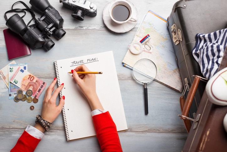 Woman-making-travel-plans.jpg