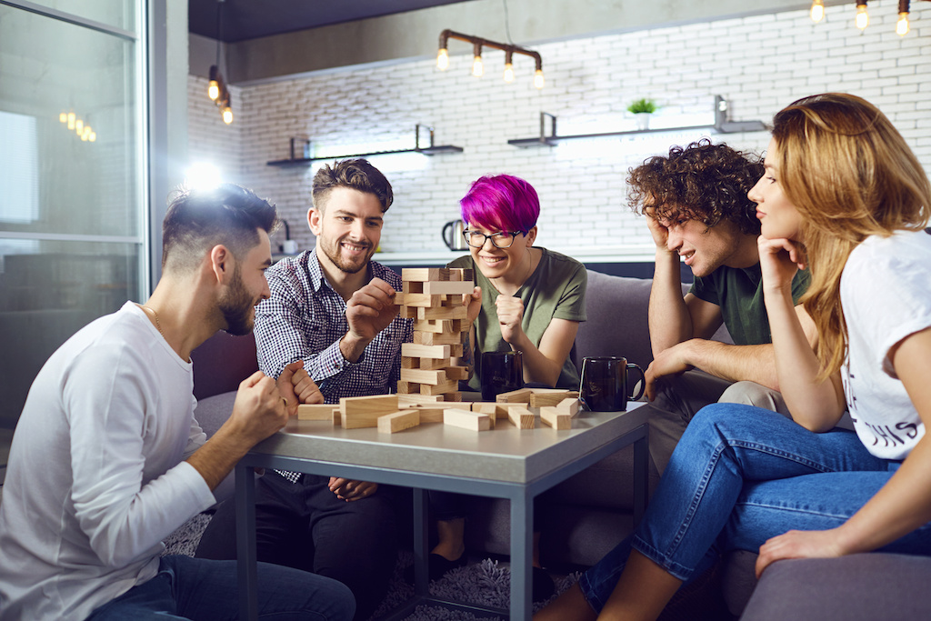 A group of friends play board games in the room.